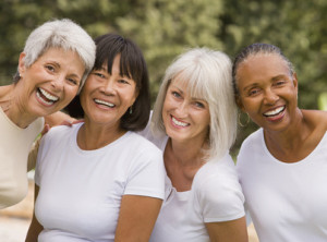 Multi-ethnic senior women laughing